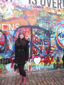 At John Lennon Wall – you can see peace signs behind me.